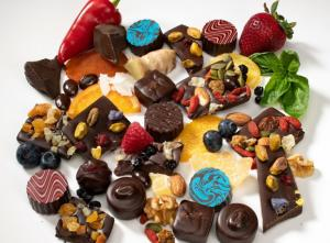 Colorful chocolates are flavored with fruits and nuts and decorated with bright colors at Cocoa Creek Chocolates.