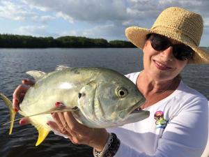 Fishing: woman holding Crevalle Jack