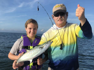 Capt. Van and child holding a Spanish mackerel