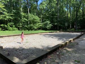 A girl plays in the filled-in remains of the Rose Island swimming pool.