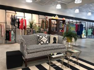 A stylish couch works as a relaxing waiting area for shoppers at Little Black Dress in Camp Hill, PA.