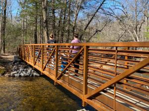 Family walking on the bridge at Pine Grove Furnace State Park