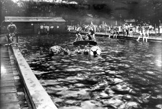 A vintage photo of people enjoying the swimming pool at the Rose Island Amusement Park.