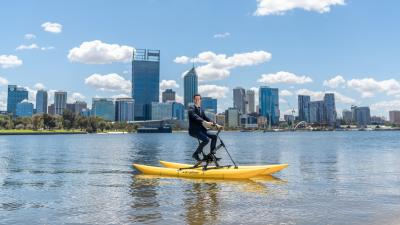 A man riding a water bike on the Swan River