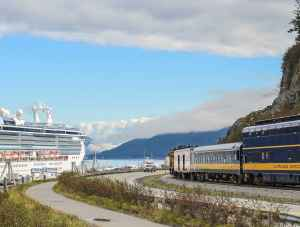 The Alaska Railroad nears a cruise ship in Whittier