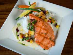 Grilled salmon plated at Haute Quarter Grill