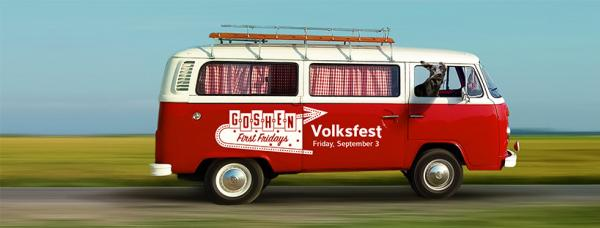 """A photo of a Volkswagen Bus painted red with white trim and white lettering on the side that reads """"Goshen First Fridays Volksfest"""""""