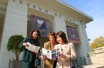 Ladies Looking at Brochure