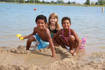 Lake Andrea kids playing in sand on the beach