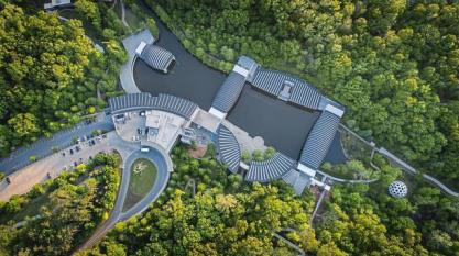 Aerial view of Crystal Bridges Museum of American Art surrounded by bright green trees