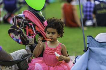Young child blowing bubbles at Fayetteville NC event