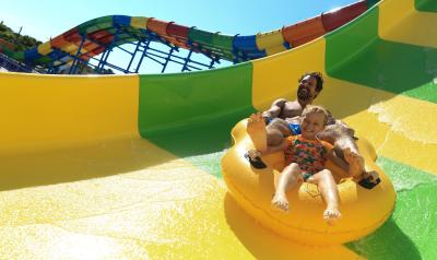 Father and daughter zooming down a waterslide at Daytona Lagoon Waterpark and Family Entertainment Center