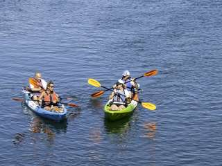 Couples kayak on Narrow River is South County, RI