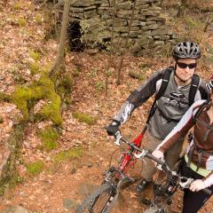 Couple Mountain Biking in the Fall