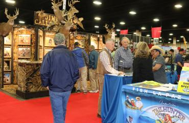 People visiting exhibitions at a show in the Mountain America Expo Center