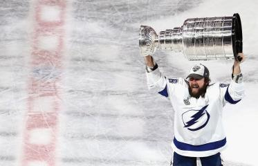 Nikita Kucherov Hoisting the 2020 Stanley Cup for the Tampa Bay Lightning
