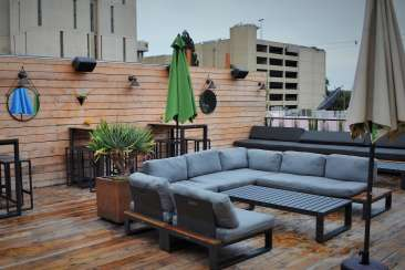 Rooftop seating at Oeste Bar in Oakland, CA
