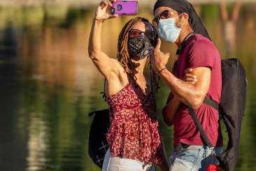 Masked Couple Posing for a selfie at Lake Merritt in Oakland, CA