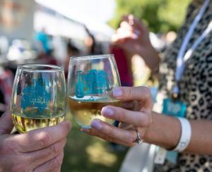 McKinney Wine & Music Festival - two ladies' hands holding glasses