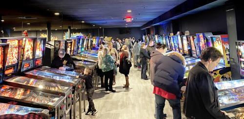 People at pinball machines at Recbar 812 in Southern Indiana