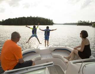 Children jumping off a boat