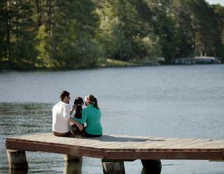 family sitting on dock