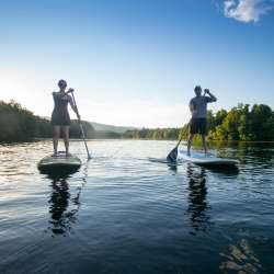 Couple paddle boarding on Beaver Creek