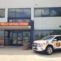 Jelly Belly bean car at entrance with store sign