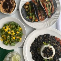 Plates of food from Madison trEats sit out on a table