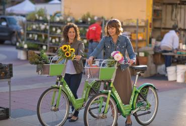 Women Riding GREENbikes with Flowers