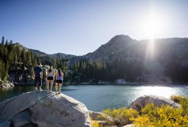 Friends hiking to a lake in Big Cottonwood Canyon