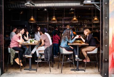 People Dining and Drinking at Purgatory