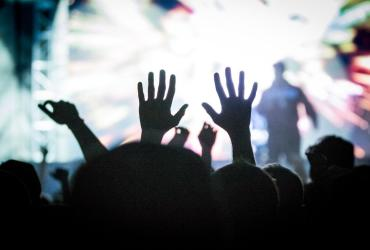 Salt Lake City Concert-goer in the crowd raising their hands
