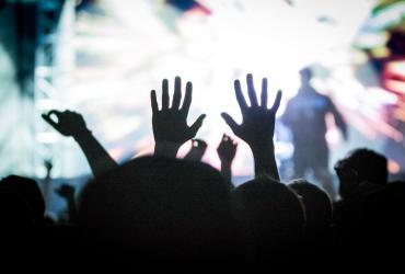 Salt Lake City Concert-goer in the crowd raising their hands