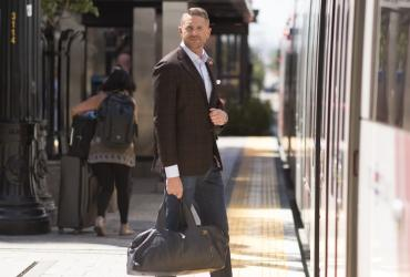 Man boarding TRAX at City Creek Center
