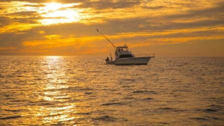 Fishing charter boat during sunset, Oswego County, New York