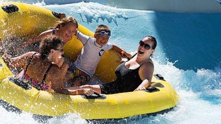 Family rides in a raft at Zoom Flume Water Park