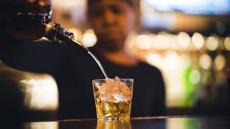 woman pours drink at Chattanooga Cigar Bar