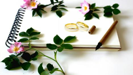 Flowers, Wedding rings and a notebook to plan your Cayuga County wedding