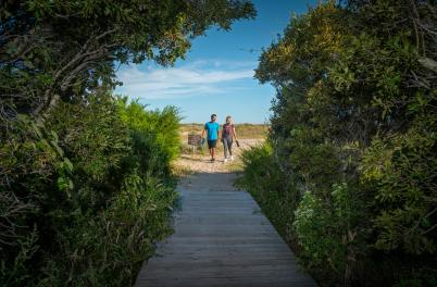 Couple Walking On Basin Trail Fort Fisher On Kure Beach NC
