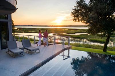A couple watching the sunset from an outdoor deck in Wilmington, NC
