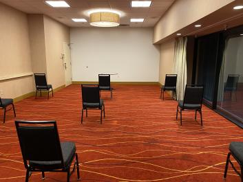 Meeting space with chairs spaced apart at the Oakland Marriott City Center