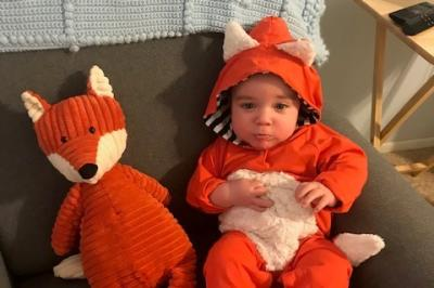Toddler dressed up as a fox