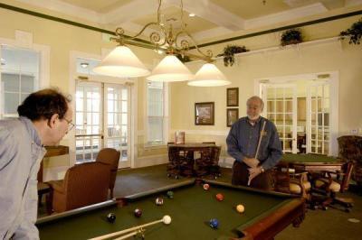 Men playing pool at Country Lane