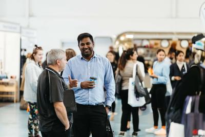 Delegates talking over coffee at an exhibition in Perth, Western Australia