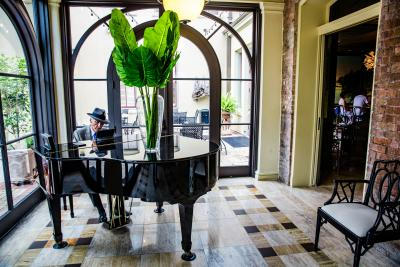 Man playing the piano during happy hour at the Southern Hotel, Covington