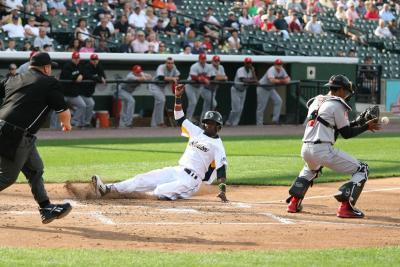 Player sliding into home base