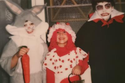 Kids in halloween costumes: Easter Bunny, Raggedy Anne and a Vampire