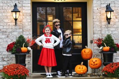 Siblings dressed up as characters from Grease