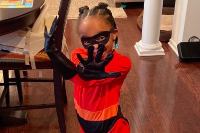 Little girls dressed up as an Incredibles character